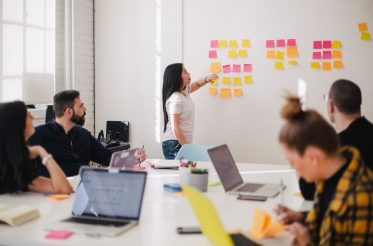 photo of team member working with postits